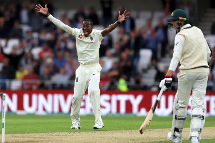 England's Jofra Archer celebrates taking the wicket of Australia's Nathan Lyon.