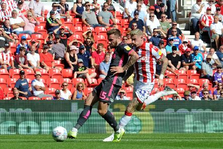 CLINICAL: Stuart Dallas fires Leeds United ahead after a superb through ball from Pablo Hernandez in Saturday's 3-0 win at Stoke City. Picture by Simon Hulme.