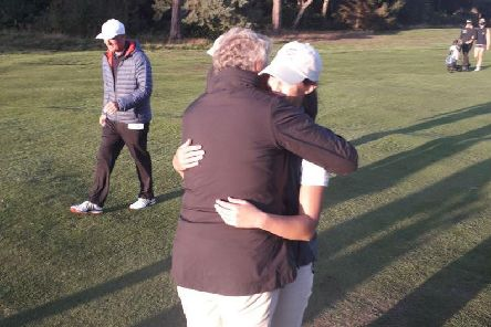 Grateful Yorkshire team captain Heather Muir hugs Melissa Wood after the 5-4 win over Norfolk (Picture: England Golf).