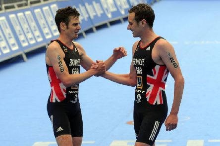 Columbia Threadneedle World Triathlon in Leeds. Jonny Brownlee congratulates his brother Alistair winning the Elite Mens Race. Picture by Tony Johnson.