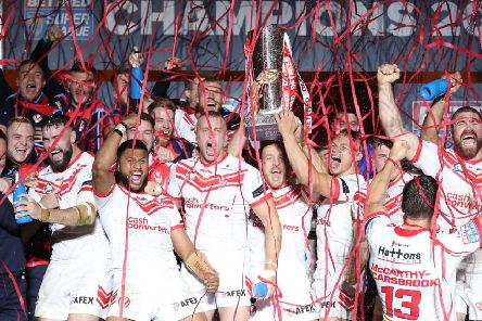 St Helens players celebrate with the trophy at Old Trafford. Picture: Martin Rickett/PA