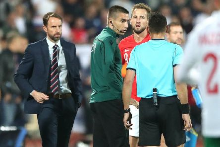 Match referee Ivan Bebek speaks to England manager Gareth Southgate (left) and Harry Kane (centre right). Picture: Nick Potts/PA