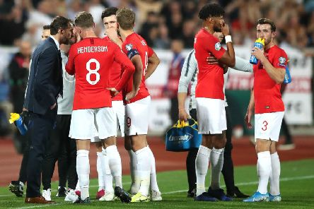 England manager Gareth Southgate (left) speaks to the players with regards to racist chanting from fans during the UEFA Euro 2020 Qualifying match at the Vasil Levski National Stadium, Sofia, Bulgaria.