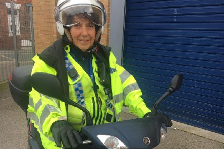 PCSO Liz Smith with her scooter.