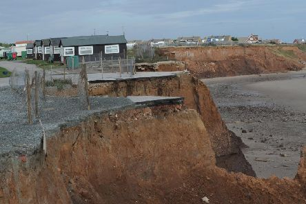 Homes left on a cliff edge due to coastal erosion at Withernsea. Picture by Simon Hulme.