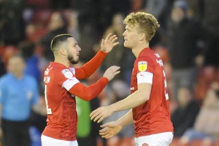 Goal: 'Cameron McGeehan is congratulated after scoring.