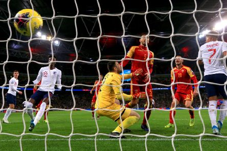 Montenegro's Aleksandar Sofranac (second right) scores an own goal to put England 6-0 up.