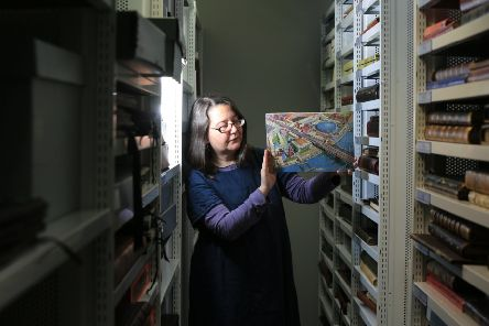 The Festival of Britain collection at Sheffield Hallam University. Pictured is archivist Heidi Sidwell with a Festival of Britain jigsaw. Picture: Chris Etchells