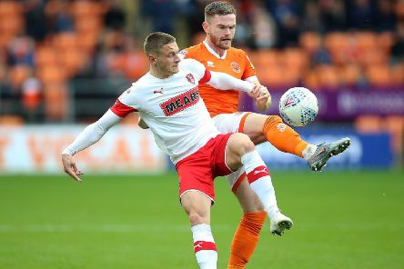 Blackpool's Ollie Turton (right) and Rotherham United's Ben Wiles battle for the ball.