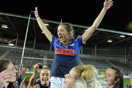 Caitlin Beevers celebrates her 18th birthday after Leeds Rhinos Grand Final win over Castleford Tigers. Picture Steve Riding.
