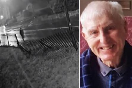 Footage has captured Colin Vasey, 81, walking down Leeds Road in Dewsbury in the pouring rain