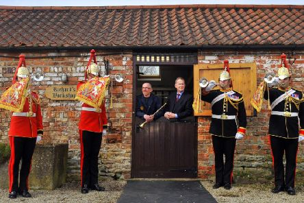 Trumpeters from the Household Cavalry paid a visit to Smith- Watkins trumpet maker from near Sheriff Hutton to play some of their instruments and played their instruments outside the workshop watched by trumpet maker Richard Wright (centre left) and Richard Smith designer and owner of the company. Picture: Gary Longbottom.