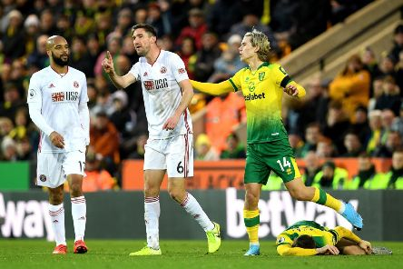 Sheffield United's Chris Basham reacts after fouling Norwich City's Kenny McLean. He received a red card, which was then rescinded by VAR (Picture: Joe Giddens/PA Wire).