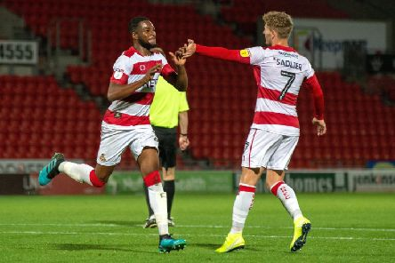 Cameron John, left, earned Doncaster Rovers a point from their home game with Milton Keynes Dons (Picture: Bruce Rollinson).
