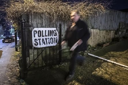 A voter leaves Woodlesford Methodist Chapel polling station in Yorkshire, as polls open in what has been billed as the most important General Election in a generation. Photo: Danny Lawson/PA Wire