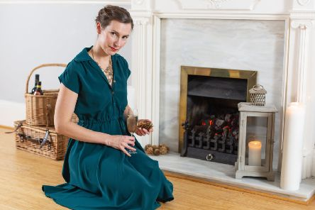 STAND OUT FROM THE CROWD: 'The thing that I really like about making my own clothes Is that no-one else has them' says Izzy Butcher, wearing a teal handmade dress. Image courtesy of Kirsten Photography.