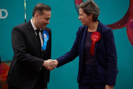Ms Creagh shakes hands with the winning Conservative candidate, Imran Ahmad-Khan.