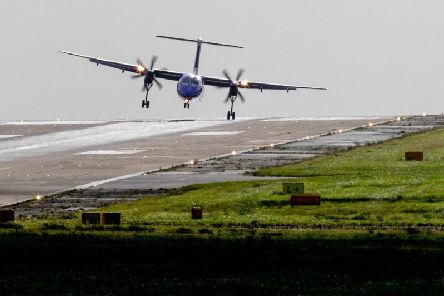 A Flybe aircraft landing at Leeds Bradford Airport