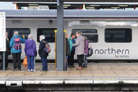 9 January 2020....      Train passengers waiting for a Northern Train service at Leeds City Station . Picture Tony Johnson