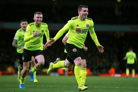 Sheffield United's John Fleck celebrates scoring at Arsenal.