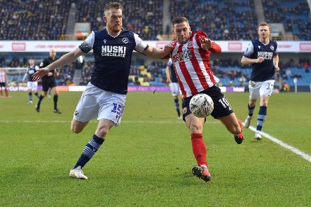 Billy Sharp is challenged by Alex Pearce. Picture: Robin Parker/Sportimage