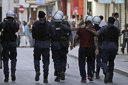 Concerns have been raised about police brutality in Bahrain. This picture shows an anti-Government protesters being detained in 2012. (AP Photo / Hasan Jamali)