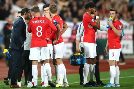 England manager Gareth Southgate (left) speaks to the players with regards to racist chanting from fans during the UEFA Euro 2020 Qualifying match at the Vasil Levski National Stadium, Sofia, Bulgaria. PA Photo. Issue date: Thursday December 12, 2019. Racist and homophobic chanting has been on a malevolent rise in recent times, and it reached its peak on a sorry night in Sofia in October when England's 6-0 European Championship qualifying win over Bulgaria was overshadowed by racist taunts.