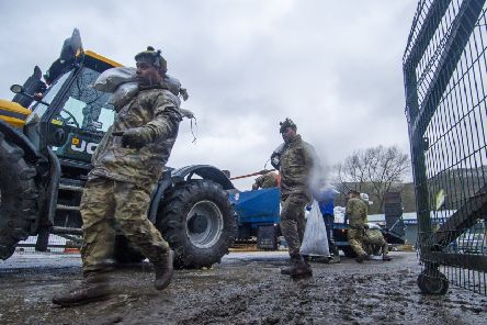 Soldiers from the Highlanders based at Catterick Garrison help build flood defences in Mytholmroyd  in preparation for Storm Dennis.