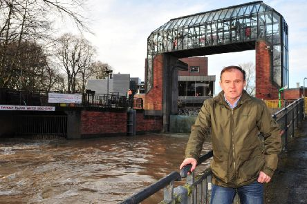George Eustice MP, Secretary of State for Environment, Food and Rural Affairs at the Foss Barrier in York. Picture Gerard Binks