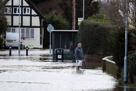 A man wades through flood water in Hereford. Picture: Steve Parsons/PA Wire