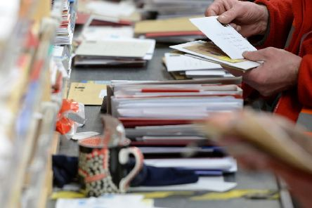 A Royal Mail sorting office as concerns grow that Christmas cards have become a tradition of the past. Do you agree with Andrew Vine that the age of the letter is dead?