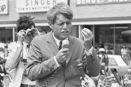 Bobby Kennedy speaks to supporters as he campaigns standing up in an open convertible in Lafayette, Indiana, during the 1968 Indiana Presidential primary which he won handily. (Photo by � Wally McNamee/CORBIS/Corbis via Getty Images)