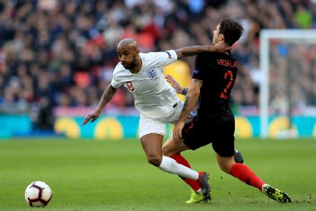 England's Fabian Delph (left) and Croatia's Sime Vrsaljko (right) battle for the ball at Wembley. Picture: Mike Egerton/PA
