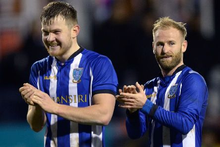 Owls duo Jordan Thorniley and Barry Bannan after victory at Luton.