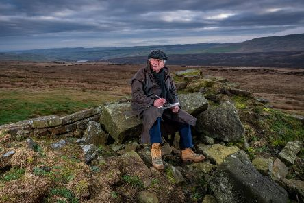 Ashley Jackson pictured working on moorland high above Holmfirth.  PIC: James Hardisty