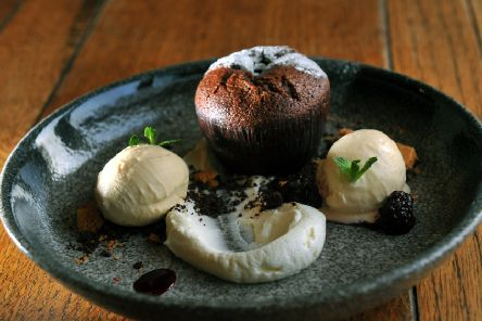 Dark chocolate fondant with honeycomb and salted caramel ice cream. PIC: Gary Longbottom