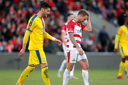 Doncaster Rovers' James Coppinger (right) shows his frustration during the FA Cup defeat to Crystal Palace at the Keepmoat Stadium. Picture: Richard Sellers/PA