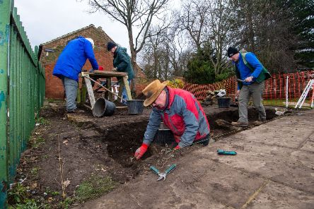 Local archaeologists and members of the Great Ayton History Society working in the Captain Cook's Memorial Garden in Great Ayton, North Yorkshire.