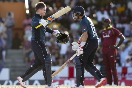 England's Jason Roy, left, celebrates his century with Joe Root who would go on to get a ton of his own in Bridgetown as they beat the West Indies (Picture: Ricardo Mazalan/AP).