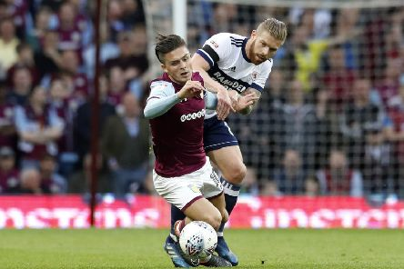 FAMILIAR FACE: Aston Villa's Jack Grealish (left) and Middlesbrough's Adam Clayton battle it out during last season's playoff semi-final, second leg. Picture: Martin Rickett/PA