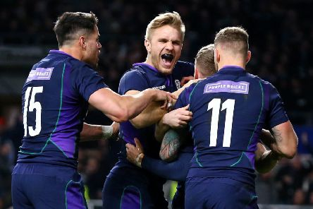Scotland's Darcy Graham is mobbed by his team-mates after scoring his side's fourth try of the game during the Guinness Six Nations match at Twickenham Stadium, London. (Picture: Gareth Fuller/PA Wire)