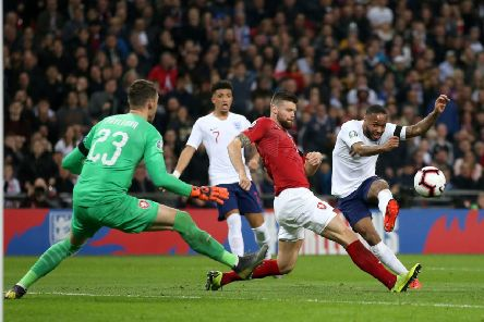 Hat-trick hero: England's Raheem Sterling scores his side's third goal at Wembley.