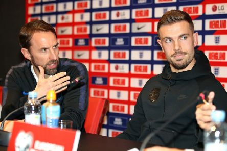 England manager Gareth Southgate, left, feels Jordan Henderson's skills are underappreciated by many. Henderson is set to win his 50th England cap against Montenegro tonight in Podgorica (Picture: Nick Potts/PA Wire).