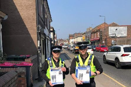 Police handing out posters appealing for information following the murder of Alena.