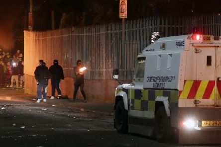 Petrol bombs are thrown at police in Creggan, Londonderry.