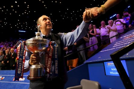 Mark Williams with the trophy after winning the 2018 Betfred World Championship.