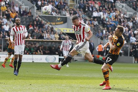 Enda Stevens powers in a bullet header to put Sheffield United three goals to the good against Hull City before half-time (Picture: Simon Bellis/Sportimage).
