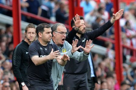 Leeds United's head coach Marcelo Bielsa, centre, and staff yell instructions from the sidelines as the side fell to defeat at Brentford to complete a pointless Easter programme (Picture: Bruce Rollinson).