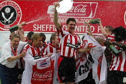 Glory day: Sheffield United's Chris Morgan celebrates with the Championship runners-up plate after the Coca-Cola Championship match against Crystal Palace at Bramall Lane in 2006.
