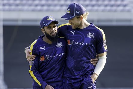 On their way: Yorkshire's Adil Rashid and David Willey.